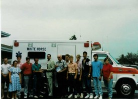 Ambulance 4-9's crew accepts the state Voluntary Ambulance Service Certification, July 9, 1991. Chief Parmer is in the middle of the group, holding the decal.