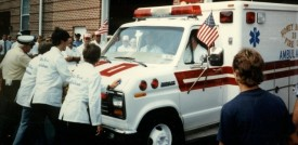 Chief Parmer (left) helping house the 1985 ambulance at Honey Brook in 1986.