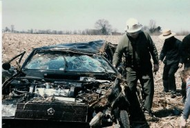 Chief Parmer examines the results of a rollover crash on Route 897 at Elam Road in 1986.