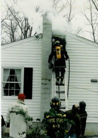 Chief Parmer (left) supervising a chimney fire on Narvon Rd. east of Gault Road... 2/5/89
