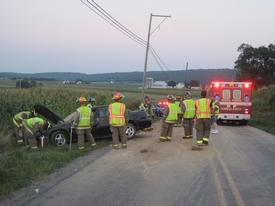 Crews operate on the scene of the second accident, at the intersection of Cains Road