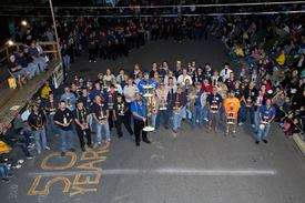 Group picture of the 49 previous championship trophies along with the 6' tall 50th trophy. (Dale Ebersol photo)