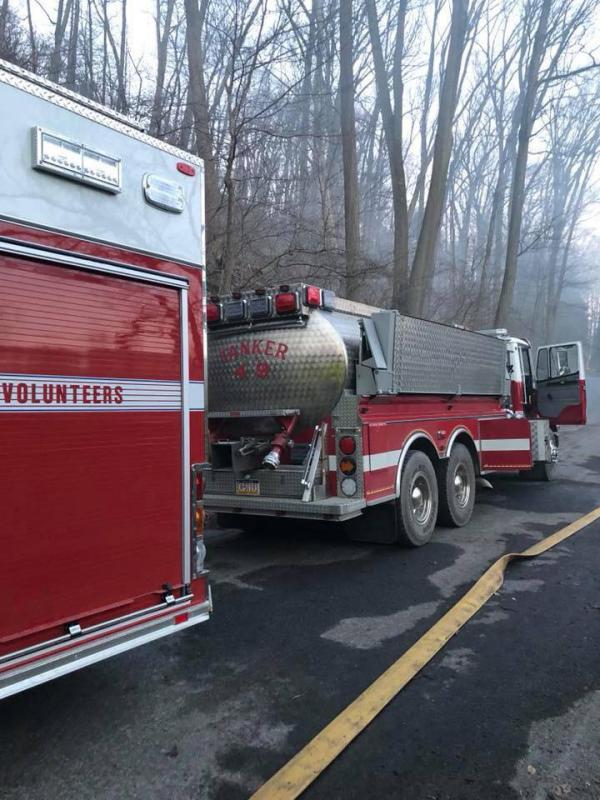Tanker 49 supplying Engine 61-1 (Upper Leacock), assisting Rawlinsville at the Martic Township woods and railroad trestle fire. (Image Courtesy of Upper Leacock Fire Company)