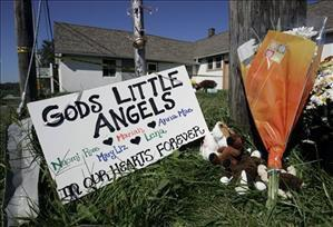 Memorial signs and flowers were placed in Nickel Mines soon after the tragedy. (AP photo)